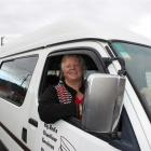 Big Red Chauffeur Services owner Judy Aitken, in her 12-seater van. Photo by Jono Edwards.