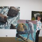 Central Stories Museum and Gallery general manager Maurice Watson, of Alexandra, shifts a work by...