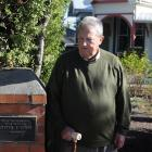 Emeritus Prof Martin Ferguson stands beside a plaque marking the site of an earlier house, once...