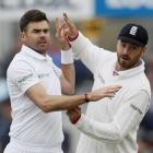James Anderson celebrates taking a wicket with James Vince. Photo: Reuters