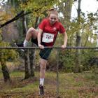Kaikorai Valley High School pupil Daneka McHaffie (13) negotiates a fence during the Otago...