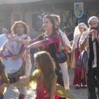 Performers parade through Obidos during its annual medieval fair. Pam Jones discovers it's hot...