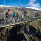 Riders enjoy the views from the Edgar Bridge on the Arrow River Bridges Ride. Photo from...