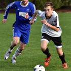 Roslyn-Wakari's Nathan Wilkie (right) looks to move the ball ahead of Mosgiel's Harley Rodeka in...