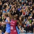Steel goal shoot Jhaniele Fowler-Reid battles for the ball with Northern Mystics goal defence...
