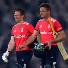 England's Eoin Morgan (L) and Jos Buttler leave the field after the match. Photo Reuters