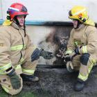 Alexandra Volunteer Fire Brigade station officer Doug McLellan (left) and firefighter Mark Briggs...