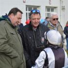 All Black coach Steve Hansen (left) and trainer Sabin Kirkland get the rundown from jockey Robert...