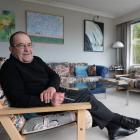 Dunedin businessman Michael Ferrari relaxes at home, with paintings from Otago artists, but isn't...