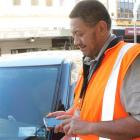 Invercargill City Council compliance team leader Kerry Kawe checks out a vehicle's expired...