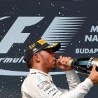 Lewis Hamilton celebrates his victory on the podium. Photo Reuters