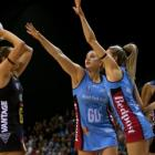 Magic goal attack Jo Harten (left) attempts a shot at goal as the Steel's Te Huinga Selby-Rickit ...