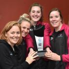 Netball South coach Lauren Piebenga (second from left) with South players (from left) Bridget...