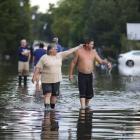 Residents survey flooding after heavy rains in Sorrento, Louisiana. Photo Reuters