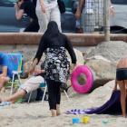 A woman wears a burkini on a beach in Marseille, France. Photo Reuters