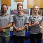 Central Otago musicians (from left) Daniel Dance, Jesse Orchard (15), and Sarah Wright (15) are...