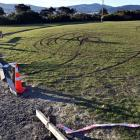 A broken fence and skid marks at Kettle Park where police discovered a burnt-out Nissan shortly...