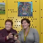 Anne Turner (left) and Angela Spears at the Stan Turner Memorial Art Auction at the University of...