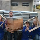 Customer Blake Cameron with Honey Hut beehive manufacturers (from left) Nadia Paine, Bella...