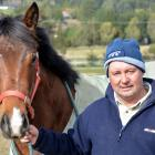 Wingatui trainer Terry Kennedy with a 2yr-old Rock 'n' Pop-Read My Lips filly at his stables on...
