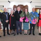 Clutha District Mayor Bryan Cadogan (second from left) is pictured with (from left) new citizens...