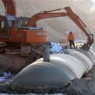 Completion of the laying of sand sausages at Ocean Beach at St Clair has been delayed after...