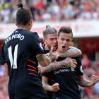 Philippe Coutinho celebrates scoring Liverpool's first goal with Alberto Moreno and Roberto...