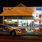 A  policeman talks to a St Kilda shopkeeper in Dunedin last night after an attempted robbery by a...