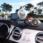 A disco globe and signatures from famous American race car driver Parnelli Jones and high...