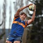 Josh Larsen takes the ball during a lineout while playing for Taieri against Southern last year....