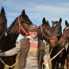Horsewoman Genevieve Crawford is surrounded by racehorses who could be part of her rehoming...