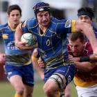 Otago's Paul Grant tries to break free from the Southland defence. Photo Getty