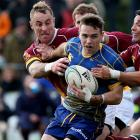 Otago's Fletcher Smith tries to break free from the Southland defence. Photo Getty