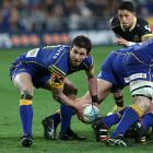 Otago halfback Josh Walden looks to get the ball away. Photo Getty Images