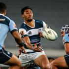 Auckland's Melani Nanai offloads the ball as the Northland defence bears down. Photo by Getty...