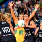 Grace Rasmussen looks to pass for the Silver Fern against Australia last year. Photo: Getty Images