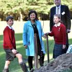 Education Minister Hekia Parata helps Kaikorai Valley College pupils Jack Hitchcox (12), Jessica...