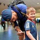 Young Highlanders fan Beau Glover (4) gets his jersey signed by winger Patrick Osborne at Dunedin...