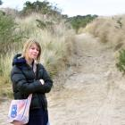 Warrington resident Jackie Hughes stands where a camper van became stuck on a beach-side track on...