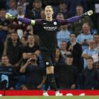 Joe Hart celebrates at the end of Manchester City's recent Champions League qualifying match....