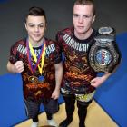 Kasib (left) and Shem Murdoch with their spoils from deeds in combat sports. Photo by Gregor...