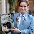 St Hilda's Collegiate School pupil Lola Garden with a handbook from the European Space Camp in...