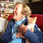 Long-standing SPCA Otago supporter Betty Elliotte enjoys some time with adoption cat ''Ginger...
