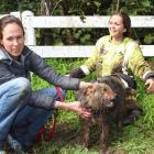 Middy was unscathed as rescuer Natalie Leranth, right, and Charis Sweeney share the moment. ...
