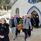 Family and friends carry the coffin of Arrowtown identity Jack Reid after his funeral in the...