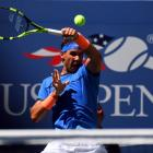 Rafael Nadal returns the ball in his first round US Open match. Photo: Reuters