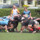 Referee Nick Webster stands by as a scrum is set during the Otago First XV semifinal between...