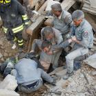 A man is rescued alive from the ruins following an earthquake in Amatrice, central Italy. Photo:...