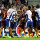 AS Roma players scuffle with FC Porta. Photo: Reuters