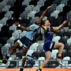 Northland winger Jone Macilai and Otago replacement fullback Tony Ensor contest a high ball...